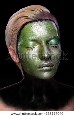 portrait of a woman with alien makeup, wet green pain all over her face, art makeup