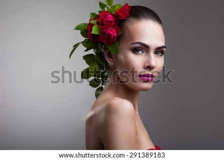 portrait of a woman with beautiful make-up and flowers on her head