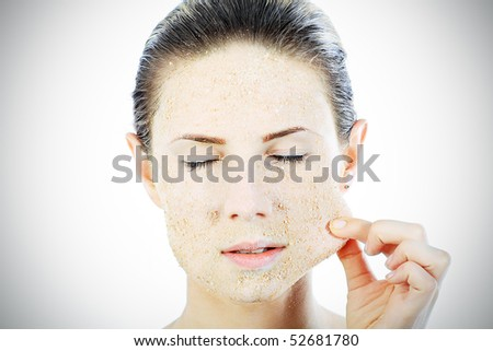 Portrait of a woman with beauty mask on her face. Spa, healthcare.