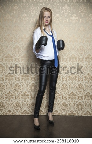 portrait of a woman with boxing glove - stock photo