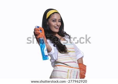 Portrait of a woman with cleaning liquid - stock photo