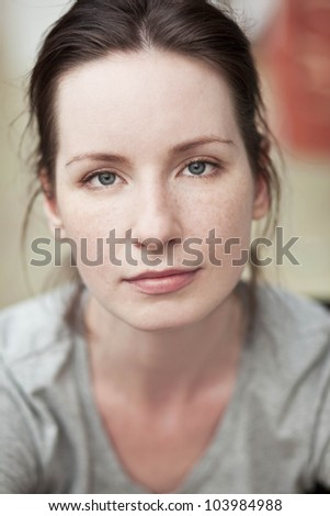 Portrait of a woman with freckles - stock photo