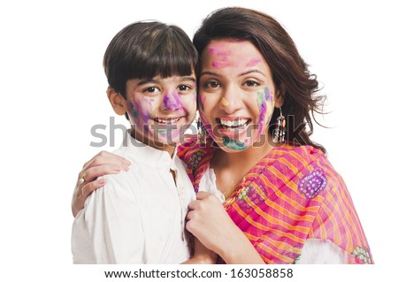 Portrait of a woman with her son celebrating Holi festival - stock photo