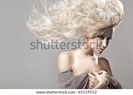 Portrait of a woman with long blonde hair - stock photo