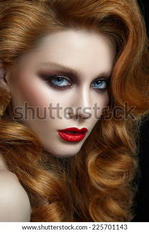 Portrait of a woman with red hair close-up