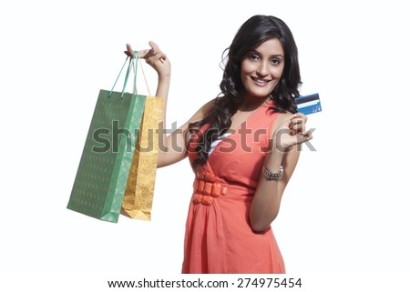 Portrait of a woman with shopping bags and credit card - stock photo