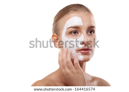 Portrait of a woman with spa mask on her face. Healthcare, medicine. Isolated