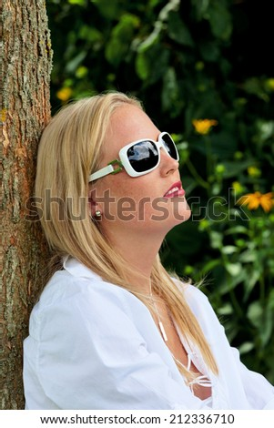 portrait of a woman with sunglasses. relaxing with protection against uv rays sonnenlichtund - stock photo