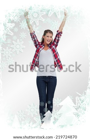 Portrait of a woman with the arms up against christmas frame
