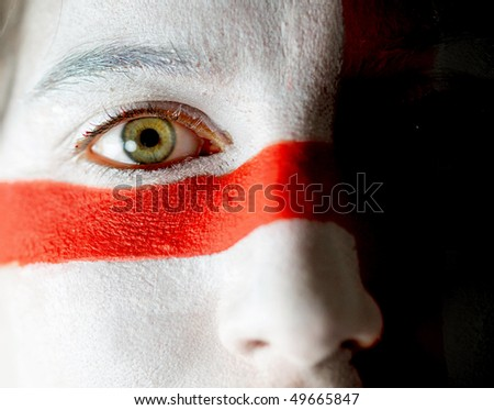 Portrait of a woman with the english flag paited on her face - stock photo