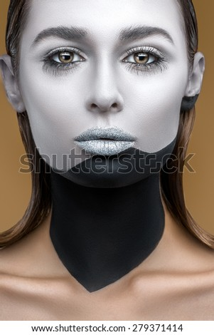 Portrait of a woman with unusual black and white makeup closeup - stock photo