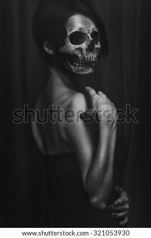 Portrait of a woman without a face, head-skull. terrible fantasy for the halloween. - stock photo