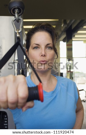 Portrait of a woman working out in gym - stock photo