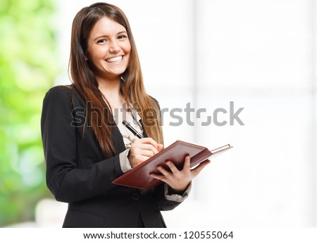 Portrait of a woman writing notes - stock photo