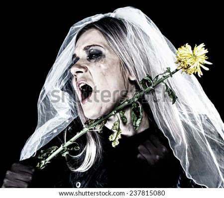 Portrait of a women in black with a veil in tears - stock photo