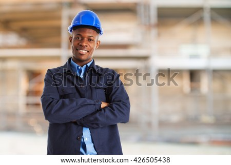 Portrait of a worker in a construction site - stock photo
