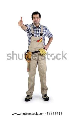 Portrait of a worker in overalls with thumb raised on white background - stock photo