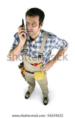 Portrait of a worker in overalls with walkie-talkie on white background - stock photo
