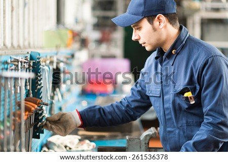 Portrait of a worker searching for the right tool - stock photo