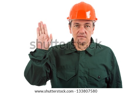 portrait of a workman in overalls and helmet showing different gestures