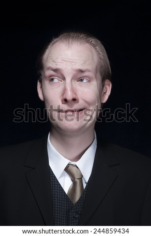 Portrait of a worried business man - stock photo