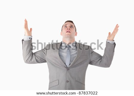Portrait of a worried entrepreneur against a white background - stock photo