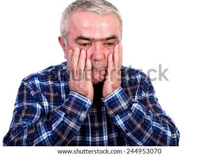 Portrait of a worried senior man holding hands on face isolated on white background - stock photo