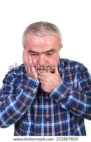 Portrait of a worried senior man isolated on white background - stock photo