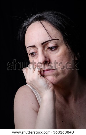 Portrait of a worried woman thinking. - stock photo