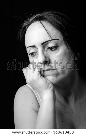 Portrait of a worried woman thinking. Black and white - stock photo
