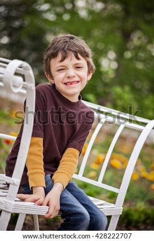 Portrait of a 7 year old boy in the garden in springtime