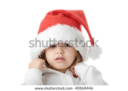 Portrait of a 5 year old girl in santa hat isolated on white background