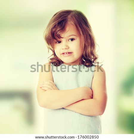 Portrait of a 5 year old girl isolated on white background - stock photo