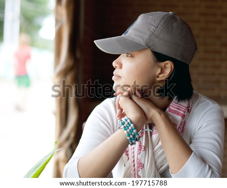 portrait of a young adult asian girl outdoor - stock photo
