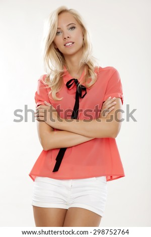 Portrait of a young adult attractive and sensuality pretty schoolgirl with beautiful blond hairs in red school uniform isolated on white background - stock photo