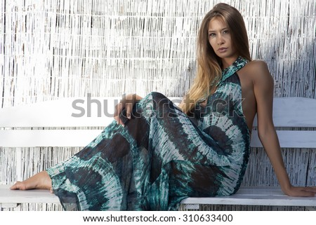 Portrait of a young adult attractive sexy and sensuality pretty active beautiful brunette woman in summertime dress on the summer sunlight beach - stock photo