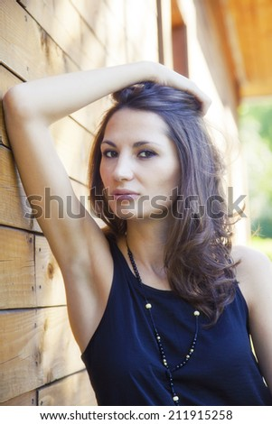 Portrait of a young adult girl outdoor - stock photo