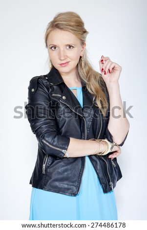 portrait of a young adult woman, studio - stock photo