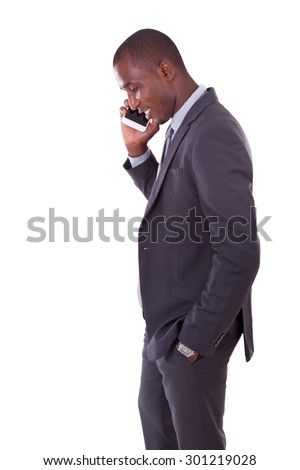 Portrait of a young African American business man making a mobile  phone call. - stock photo