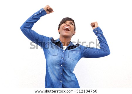 Portrait of a young african american woman cheering with arms raised - stock photo