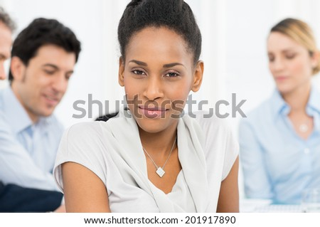Portrait Of A Young African Businesswoman Sitting In Front Of Colleague - stock photo