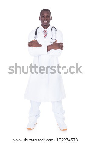 Portrait Of A Young African Male Doctor Over White Background - stock photo