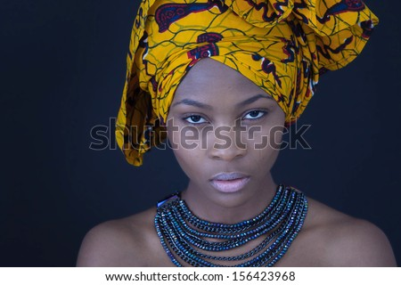 Portrait of a young African woman in traditional dress.  - stock photo