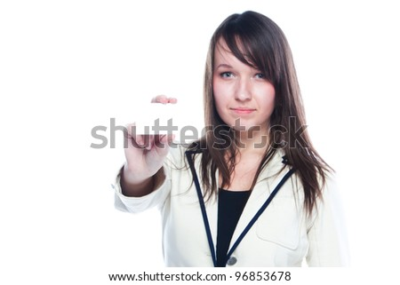 Portrait of a young and beautiful girl with a blank business card in the hands of