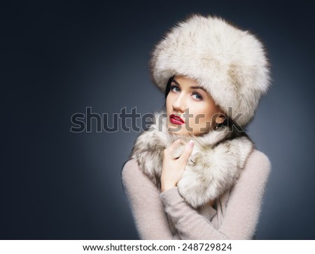 Portrait of a young and beautiful lady in a typical Russian winter clothes - stock photo