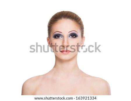 Portrait of a young and beautiful woman in makeup isolated on white - stock photo