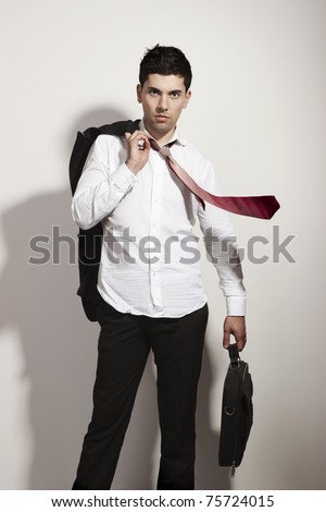 Portrait of a young and fashion businessman over a white background - stock photo