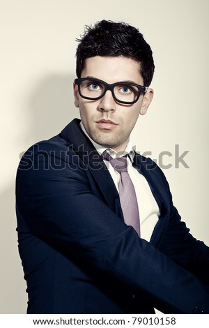 Portrait of a young and fashion businessman with nerd glasses