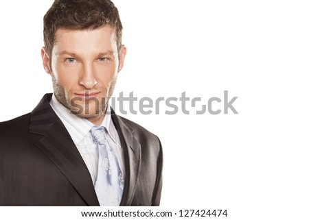 portrait of a young and handsome businessman on white background