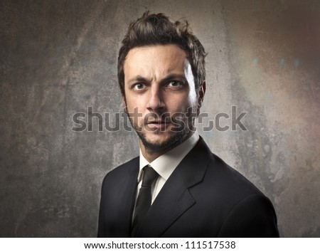 Portrait of a young angry businessman - stock photo